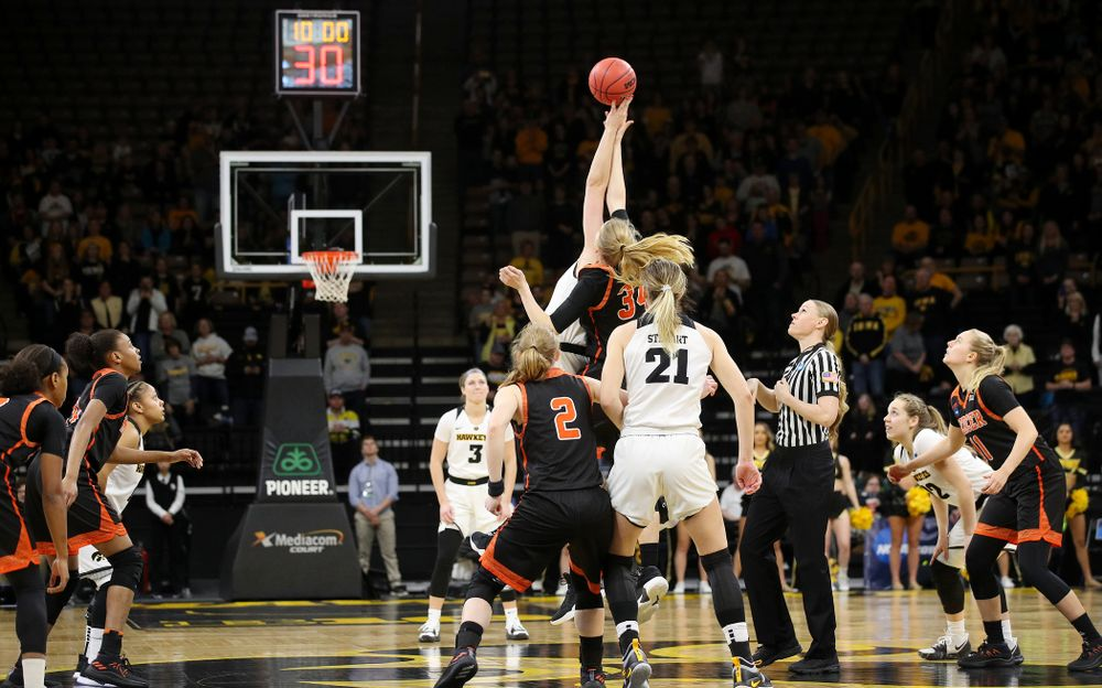 Iowa Hawkeyes forward Megan Gustafson (10) wins the opening tip during the first round of the 2019 NCAA Women's Basketball Tournament at Carver Hawkeye Arena in Iowa City on Friday, Mar. 22, 2019. (Stephen Mally for hawkeyesports.com)