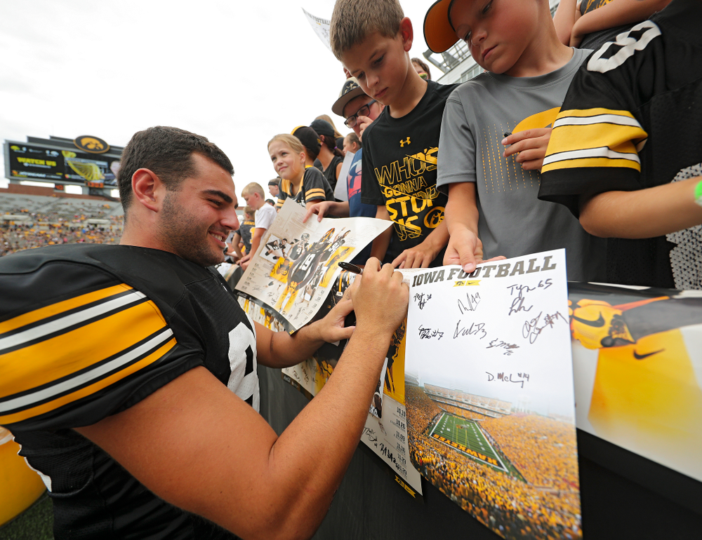 Iowa Hawkeyes wide receiver Nico Ragaini (89) signs an autograph during Kids Day at Kinnick Stadium in Iowa City on Saturday, Aug 10, 2019. (Stephen Mally/hawkeyesports.com)