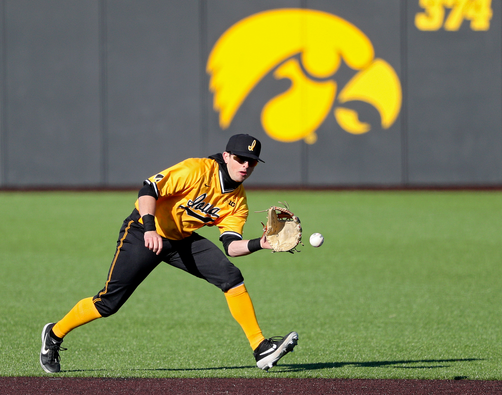 Iowa Hawkeyes second baseman Mitchell Boe (4) fields a ground ball during the fourth inning of their game at Duane Banks Field in Iowa City on Tuesday, Apr. 2, 2019. (Stephen Mally/hawkeyesports.com)