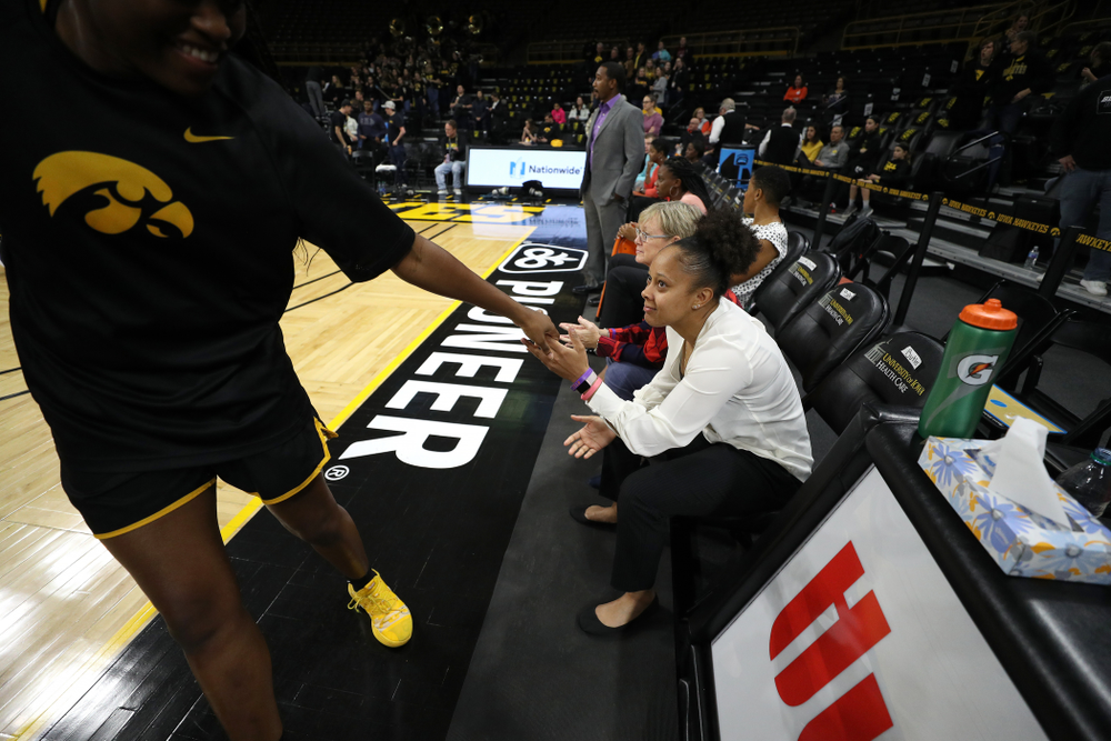Former Hawkeye and Clemson graduate assistant Tania Davis slaps hands with Iowa Hawkeyes guard Alexis Sevillian (5) before their game Wednesday, December 4, 2019 at Carver-Hawkeye Arena. (Brian Ray/hawkeyesports.com)