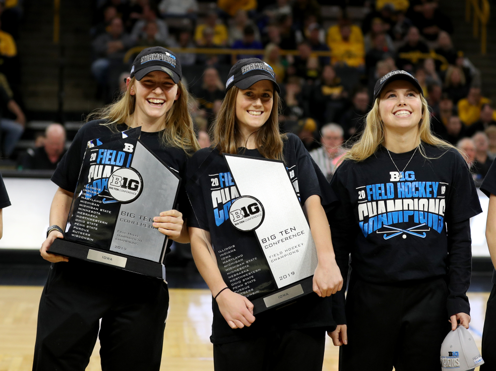 Katie Birch, Sophie Sunderland, and Leslie Speight and the rest of the Iowa Field Hockey team are recognized during the Iowa Hawkeyes game against the Ohio State Buckeyes Thursday, February 20, 2020 at Carver-Hawkeye Arena. (Brian Ray/hawkeyesports.com)