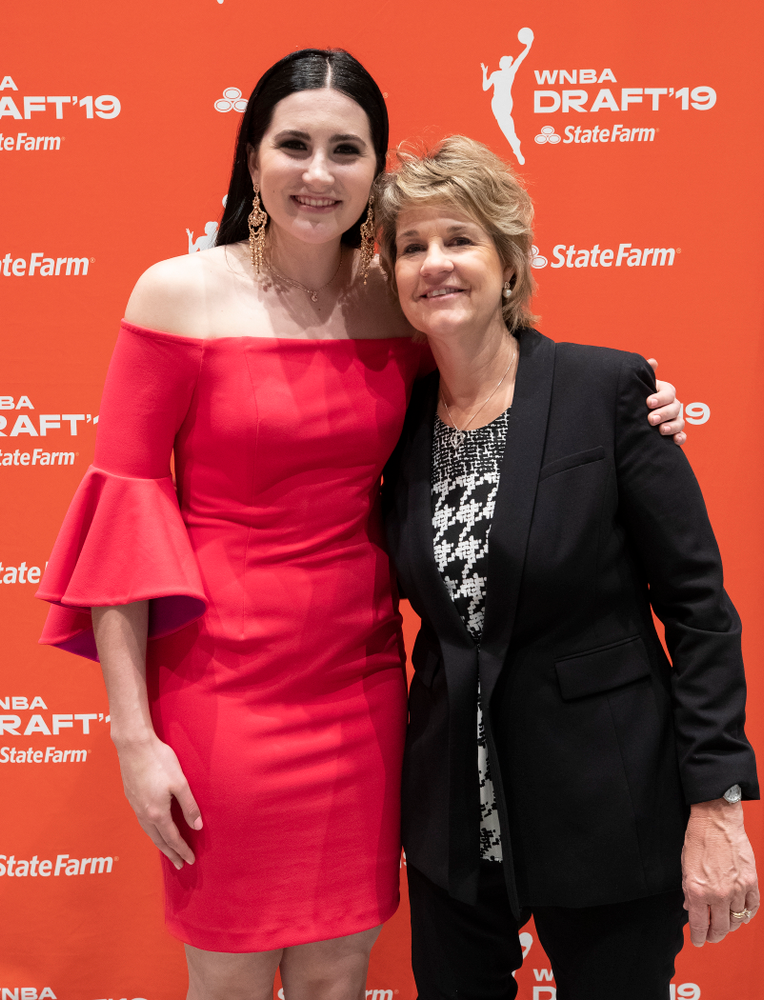 Iowa Hawkeyes forward Megan Gustafson (10) with head coach Lisa Bluder after being selected by the Dallas Wings in the second round of the 2019 WNBA Draft Wednesday, April 10, 2019 at Nike New York Headquarters in New York City. (Brian Ray/hawkeyesports.com)