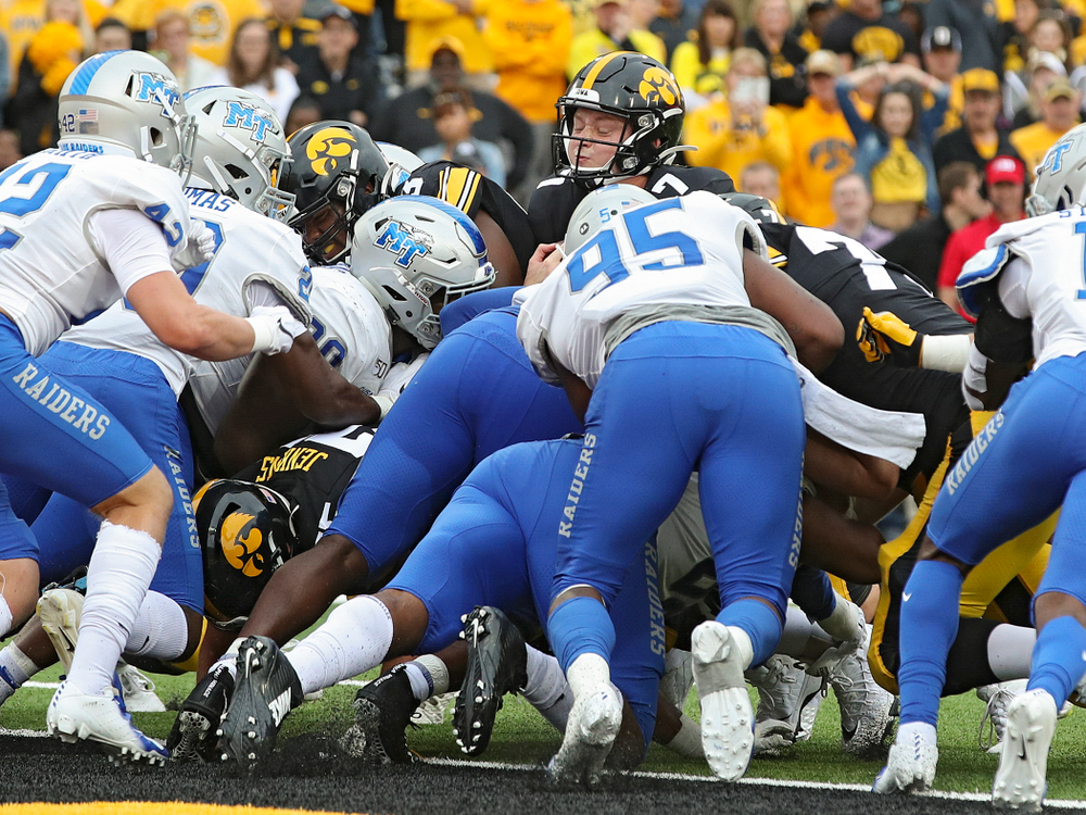 Iowa Hawkeyes quarterback Spencer Petras (7) scores a touchdown on a 1-yard run during fourth quarter of their game at Kinnick Stadium in Iowa City on Saturday, Sep 28, 2019. (Stephen Mally/hawkeyesports.com)