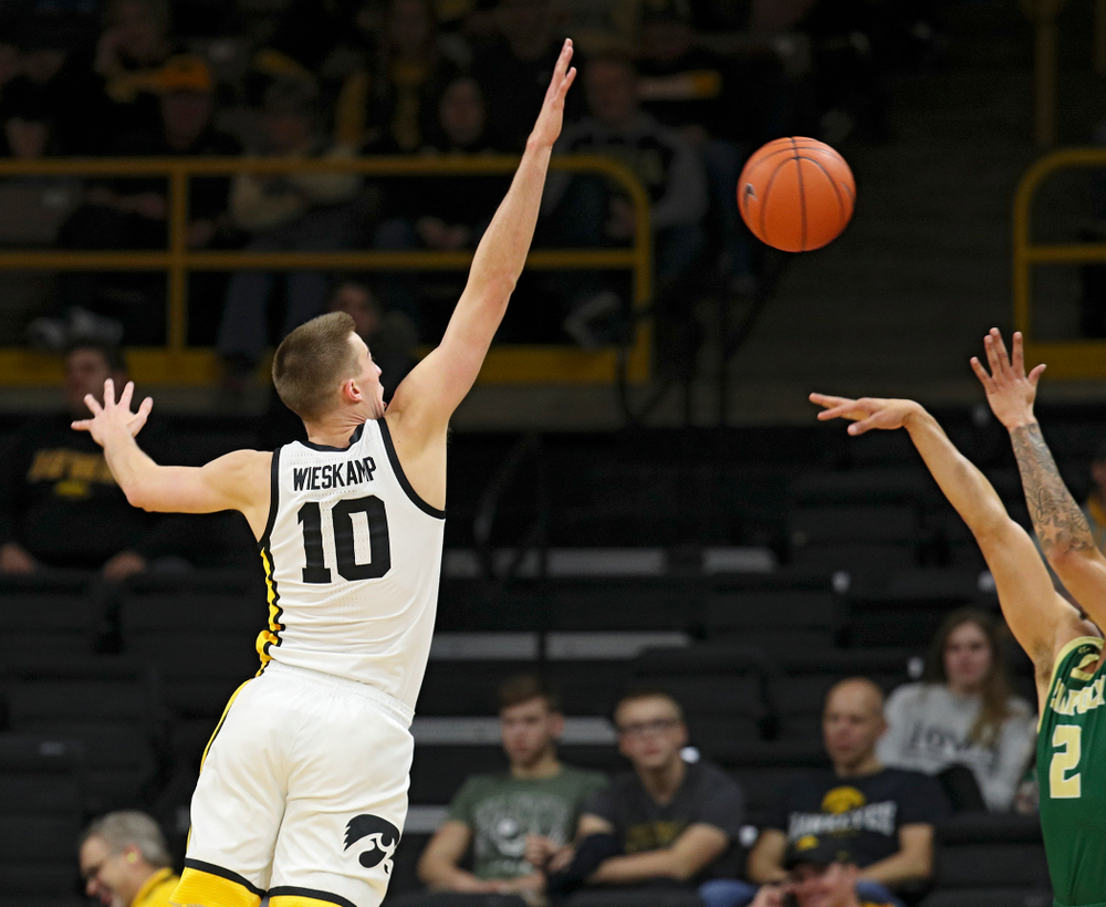 Iowa Hawkeyes guard Joe Wieskamp (10) blocks a shot by Cal Poly Mustangs forward Malek Harwell (2) during the second half of their game at Carver-Hawkeye Arena in Iowa City on Sunday, Nov 24, 2019. (Stephen Mally/hawkeyesports.com)