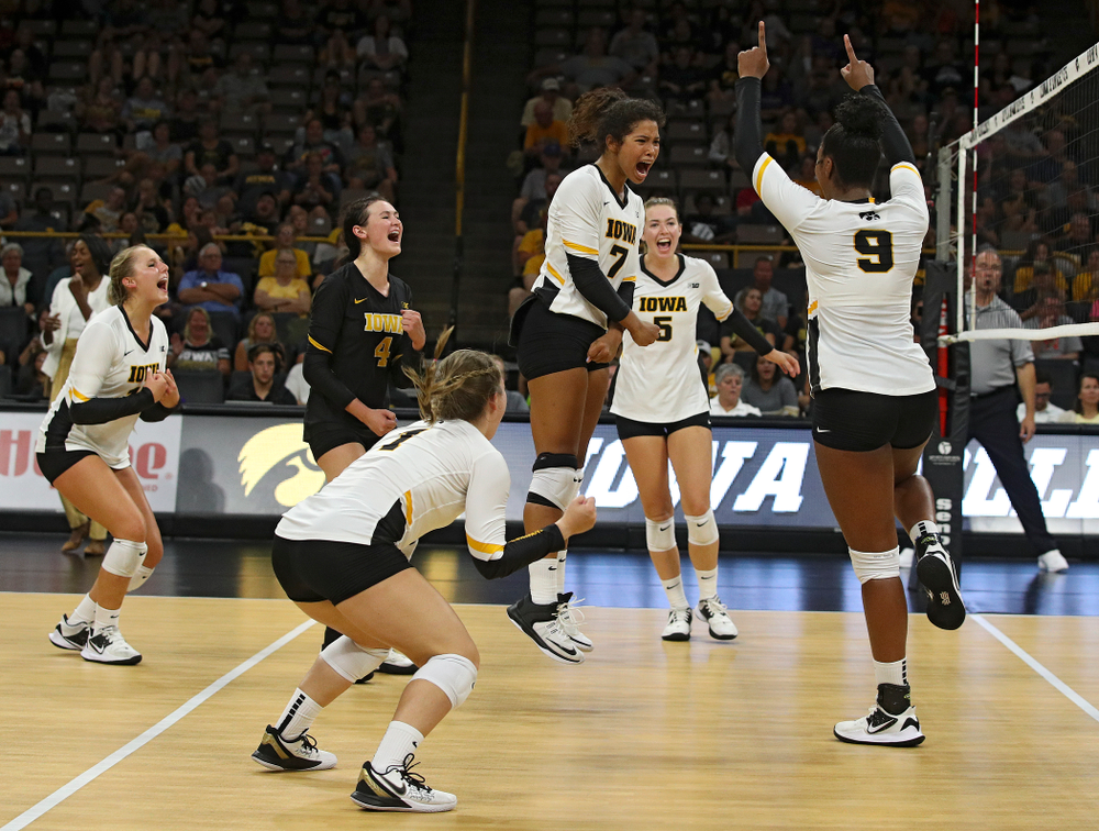 Iowa's Maddie Slagle (15), Halle Johnston (4), Joslyn Boyer (1), Brie Orr (7), Meghan Buzzerio (5), and Amiya Jones (9) celebrate a score during their Big Ten/Pac-12 Challenge match at Carver-Hawkeye Arena in Iowa City on Saturday, Sep 7, 2019. (Stephen Mally/hawkeyesports.com)