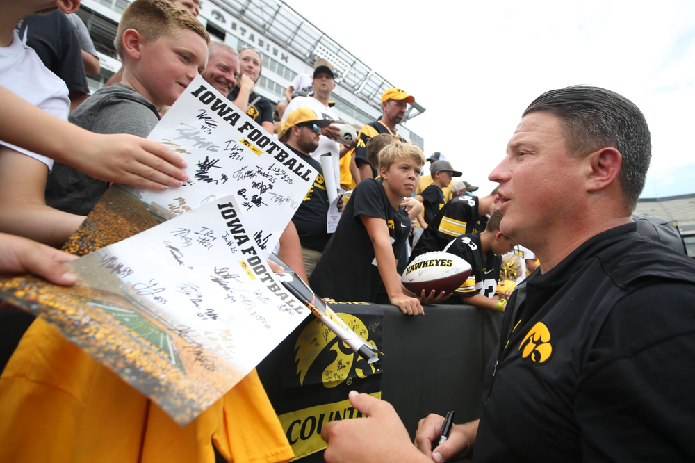 Iowa Hawkeyes offensive coordinator Brian Ferentz signs autographs during Kids Day at Kinnick Stadium on Saturday, August 10, 2019. (Lily Smith/hawkeyesports.com)