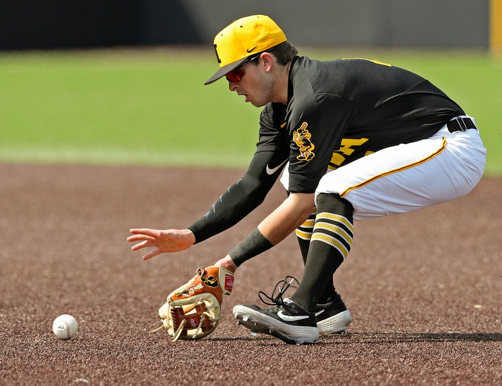 Iowa Hawkeyes second baseman Mitchell Boe (4) fields a ground ball during the third inning of their game against Rutgers at Duane Banks Field in Iowa City on Saturday, Apr. 6, 2019. (Stephen Mally/hawkeyesports.com)