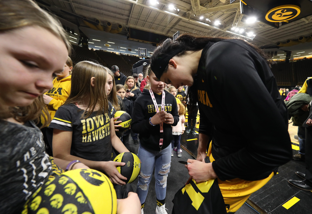 Iowa Hawkeyes forward Megan Gustafson (10) takes, photos, signs autographs, and gives hugs following senior day ceremonies Sunday, March 3, 2019 at Carver-Hawkeye Arena. (Brian Ray/hawkeyesports.com)