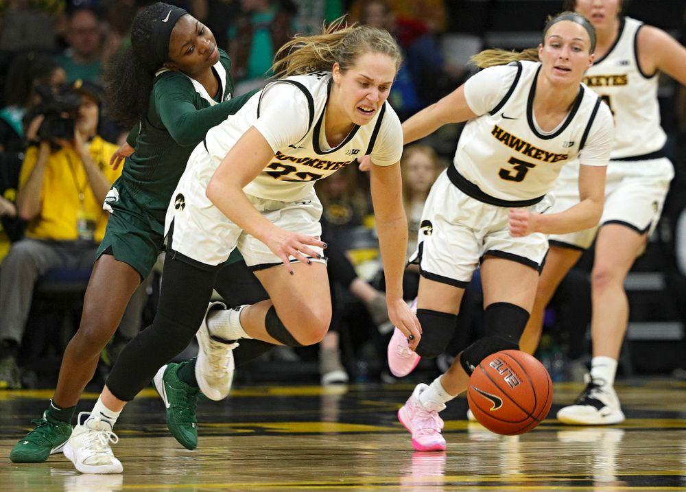 Iowa Hawkeyes guard Kathleen Doyle (22) steals the ball away during the fourth quarter of their game at Carver-Hawkeye Arena in Iowa City on Sunday, January 26, 2020. (Stephen Mally/hawkeyesports.com)