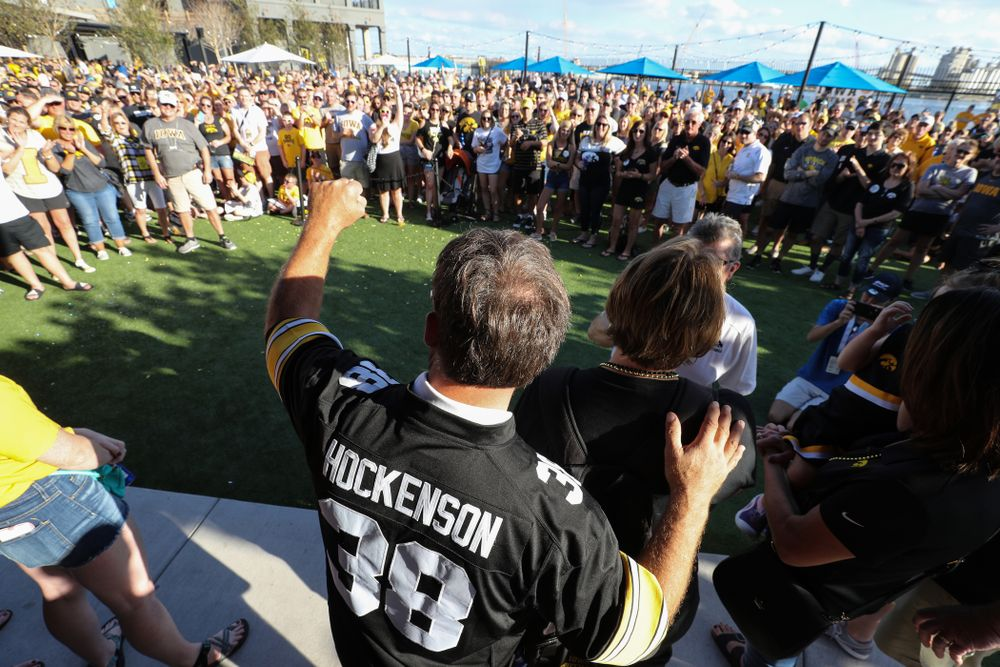"""Fans chant """"One More Year"""" as the Voice of the Hawkeyes Gary Dolphin introduces the family of Iowa Hawkeyes tight end T.J. Hockenson (38) during the Hawkeye Huddle Monday, December 31, 2018 at Sparkman Wharf in Tampa, FL. (Brian Ray/hawkeyesports.com)"""