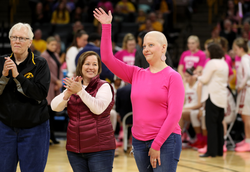 Women affected by cancer are introduced during the Iowa Hawkeyes game against the Wisconsin Badgers Sunday, February 16, 2020 at Carver-Hawkeye Arena. (Brian Ray/hawkeyesports.com)