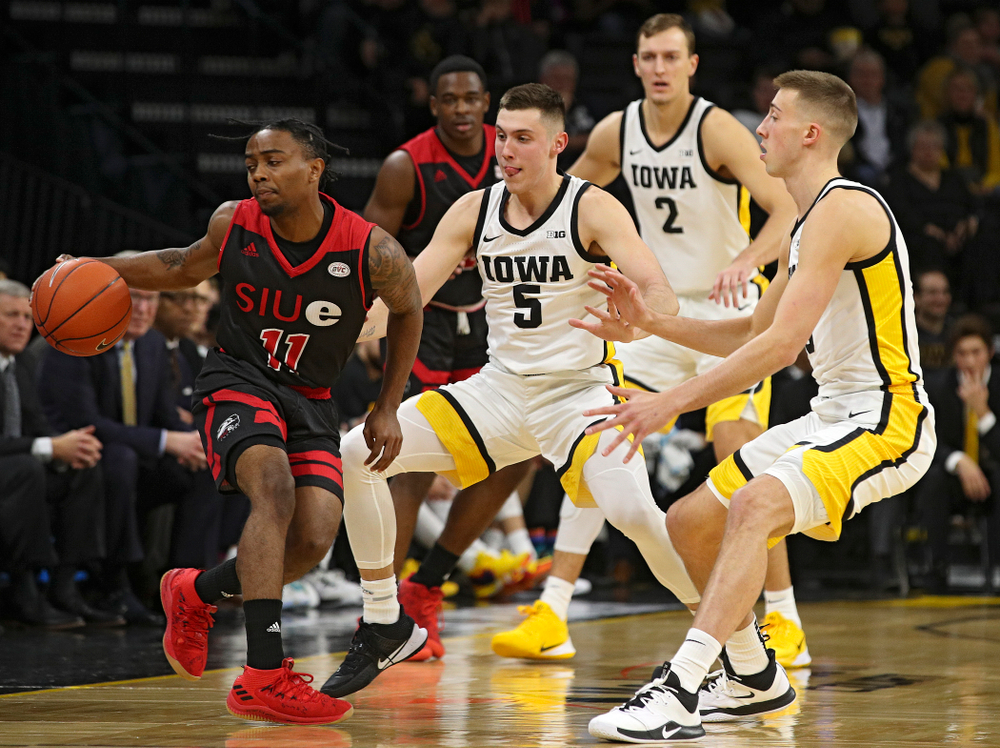 Iowa Hawkeyes guard CJ Fredrick (5) and guard Joe Wieskamp (10) pressure SIU Edwardsville Cougars guard Tyresse Williford (11) which led to a turnover during the first half of their game at Carver-Hawkeye Arena in Iowa City on Friday, Nov 8, 2019. (Stephen Mally/hawkeyesports.com)