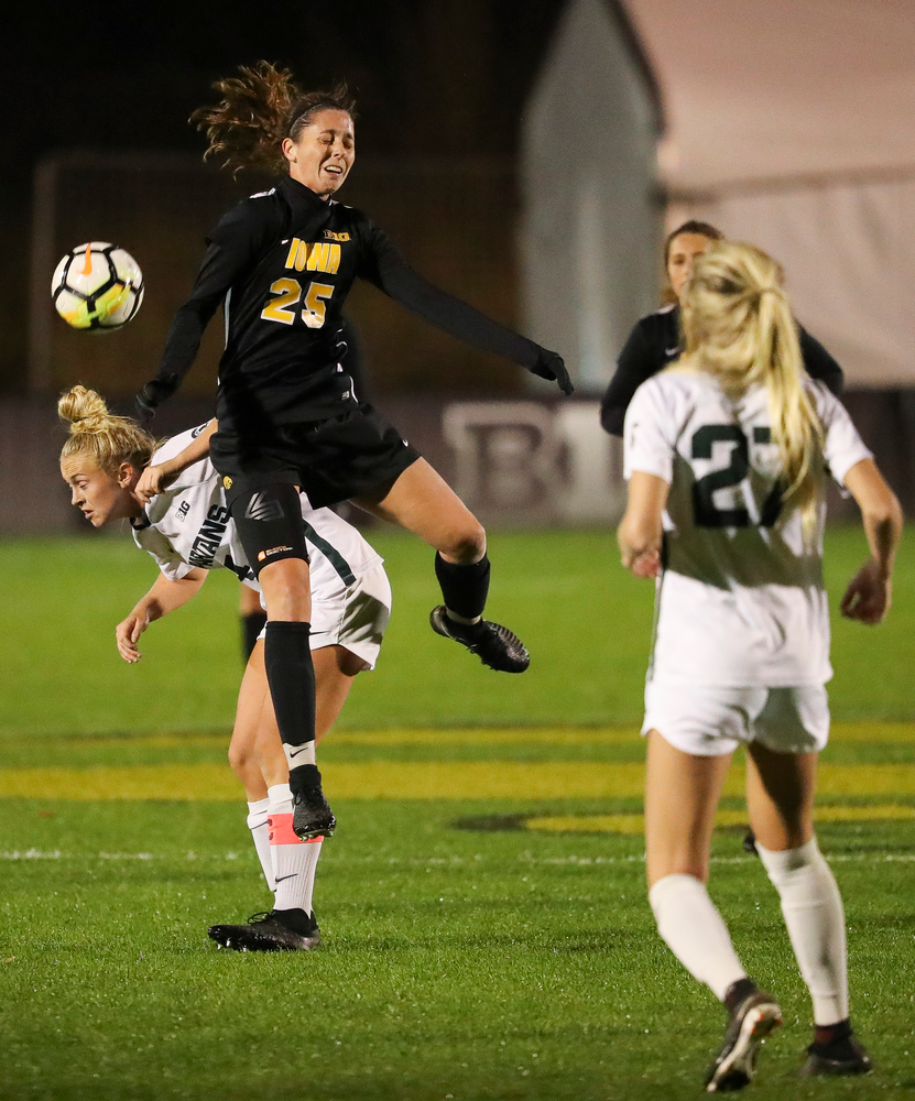 Iowa Hawkeyes midfielder Josie Durr (25) heads the ball during a game against Michigan State at the Iowa Soccer Complex on October 12, 2018. (Tork Mason/hawkeyesports.com)