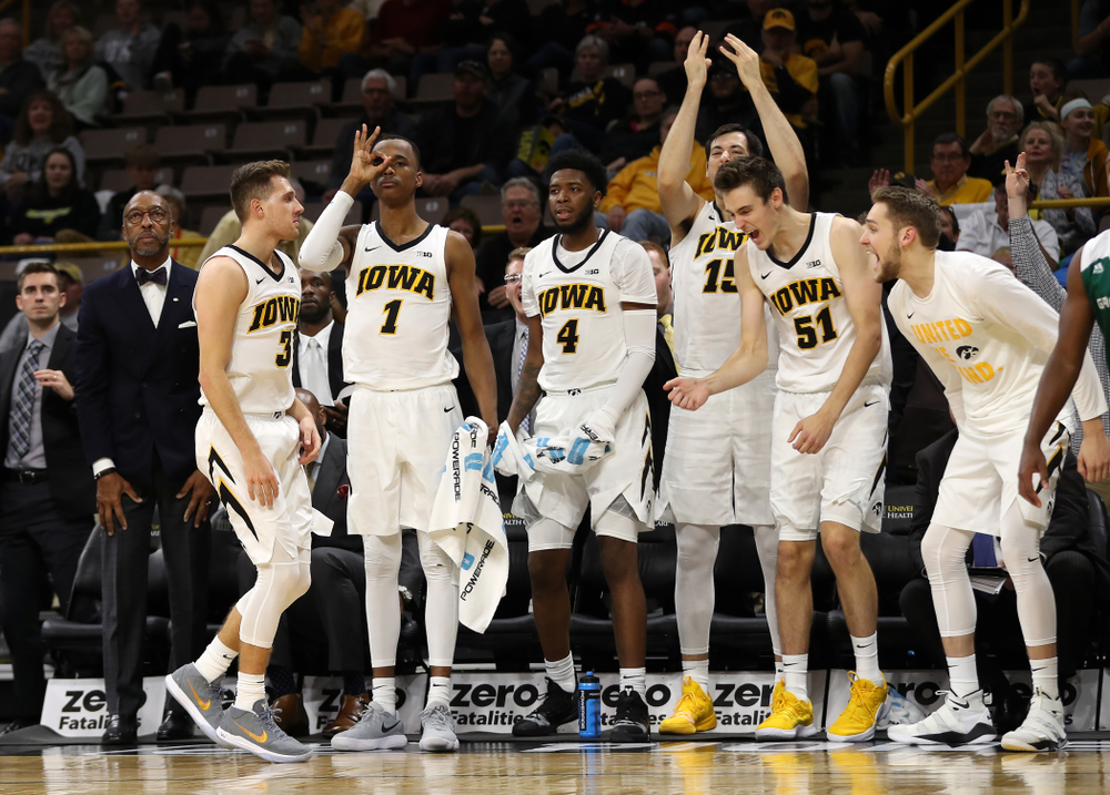 Iowa Hawkeyes guard Jordan Bohannon (3) knocks down a three point basket as guard Maishe Dailey (1) and forward Nicholas Baer (51) celebrate against UW Green Bay Sunday, November 11, 2018 at Carver-Hawkeye Arena. (Brian Ray/hawkeyesports.com)