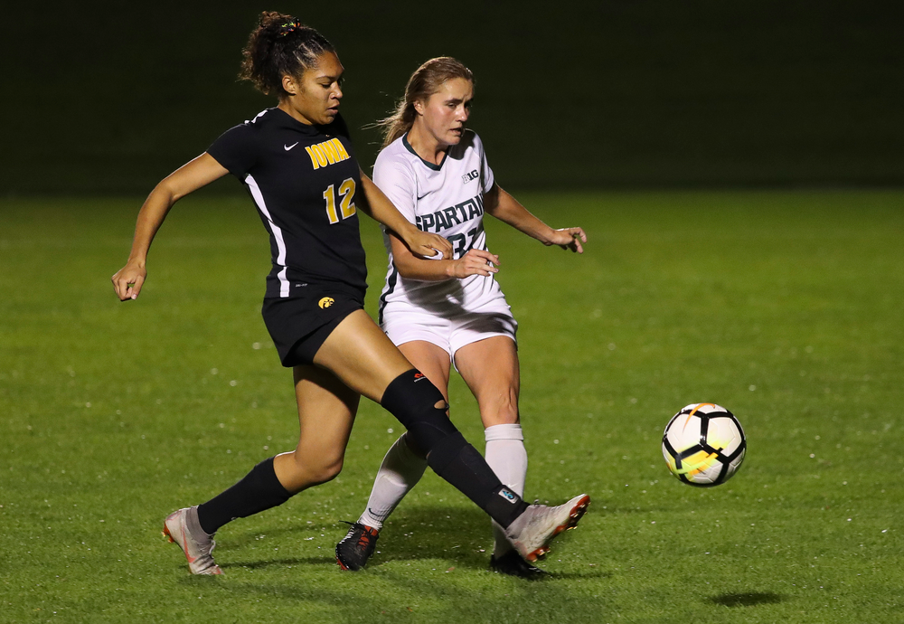Iowa Hawkeyes forward Olivia Fiegel (12) fights for possession during a game against Michigan State at the Iowa Soccer Complex on October 12, 2018. (Tork Mason/hawkeyesports.com)