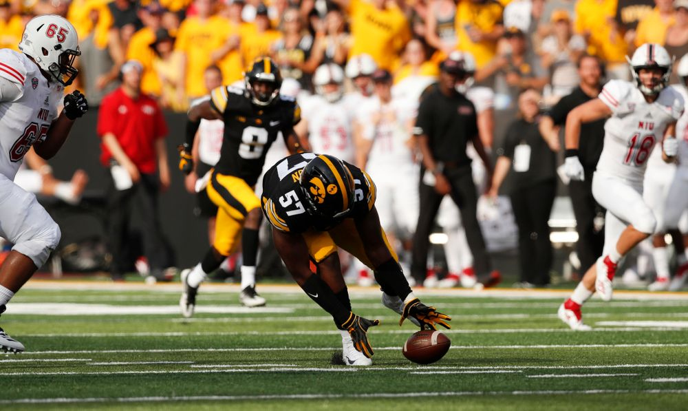 Iowa Hawkeyes defensive end Chauncey Golston (57) scoops up and returns a fumble against the Northern Illinois Huskies Saturday, September 1, 2018 at Kinnick Stadium. (Brian Ray/hawkeyesports.com)