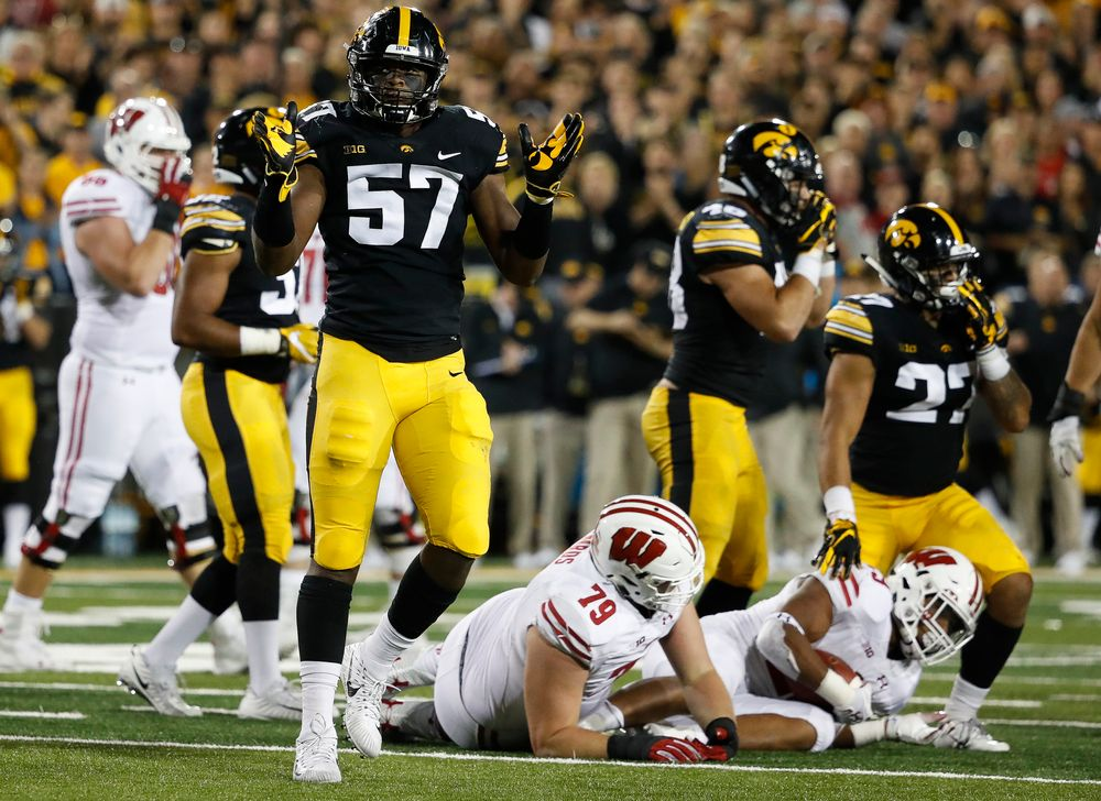 Iowa Hawkeyes defensive end Chauncey Golston (57) reacts after making a tackle during a game against Wisconsin at Kinnick Stadium on September 22, 2018. (Tork Mason/hawkeyesports.com)