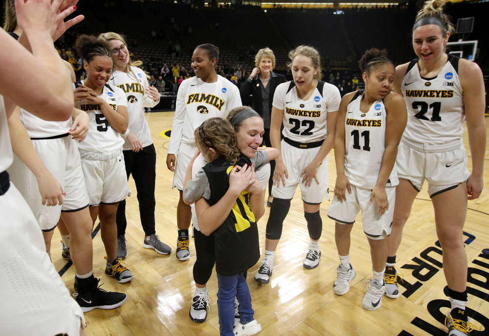 Iowa Hawkeyes guard Makenzie Meyer (3) gets a hug from Harper Stribe after winning their second round game in the 2019 NCAA Women's Basketball Tournament at Carver Hawkeye Arena in Iowa City on Sunday, Mar. 24, 2019. (Stephen Mally for hawkeyesports.com)