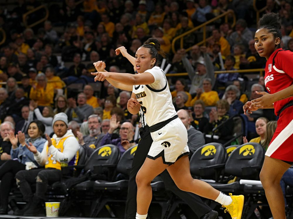 Iowa Hawkeyes guard Alexis Sevillian (5) points after making a 3-pointer during the second quarter of the game at Carver-Hawkeye Arena in Iowa City on Thursday, February 6, 2020. (Stephen Mally/hawkeyesports.com)