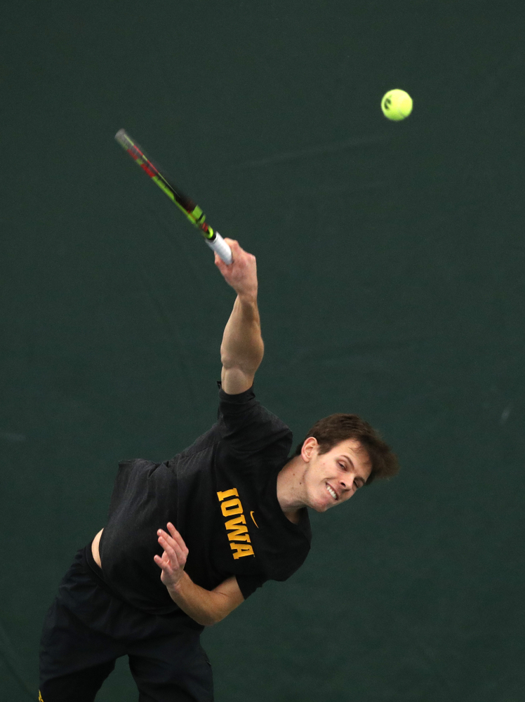 Piotr Smietana against the Miami Hurricanes Friday, February 8, 2019 at the Hawkeye Tennis and Recreation Complex. (Brian Ray/hawkeyesports.com)