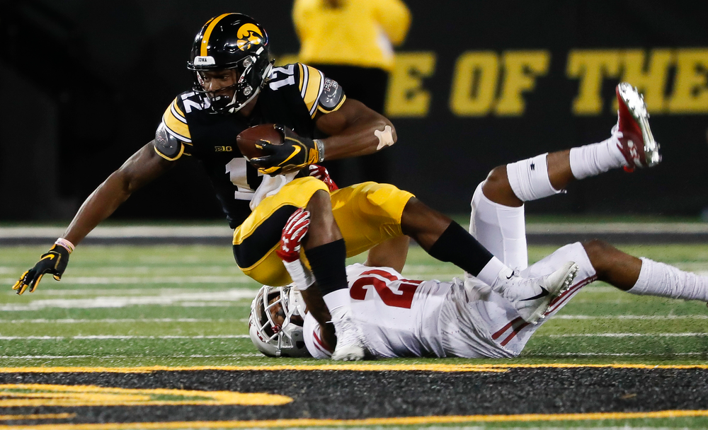 Iowa Hawkeyes wide receiver Brandon Smith (12) is brought down after making a first down reception during a game against Wisconsin at Kinnick Stadium on September 22, 2018. (Tork Mason/hawkeyesports.com)