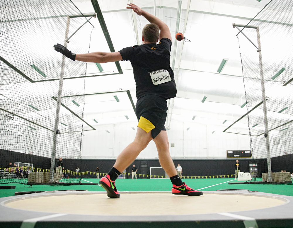 Iowa's Jordan Hawkins throws during the men's weight throw event at the Hawkeye Tennis and Recreation Complex in Iowa City on Friday, January 31, 2020. (Stephen Mally/hawkeyesports.com)