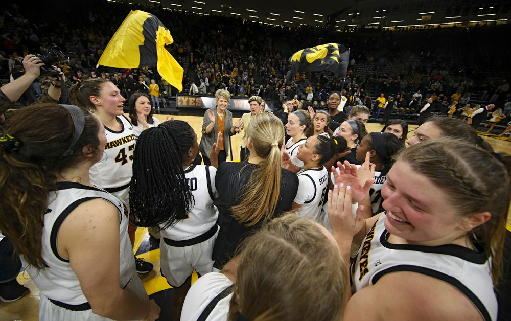 The Iowa Hawkeyes celebrate after winning their game at Carver-Hawkeye Arena in Iowa City on Thursday, February 6, 2020. (Stephen Mally/hawkeyesports.com)