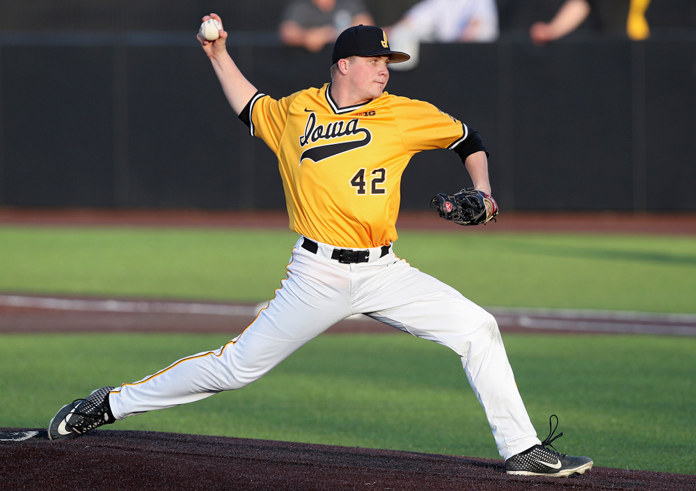 Iowa Hawkeyes pitcher Trace Hoffman (42) delivers to the plate during the eighth inning of their game against Northern Illinois at Duane Banks Field in Iowa City on Tuesday, Apr. 16, 2019. (Stephen Mally/hawkeyesports.com)