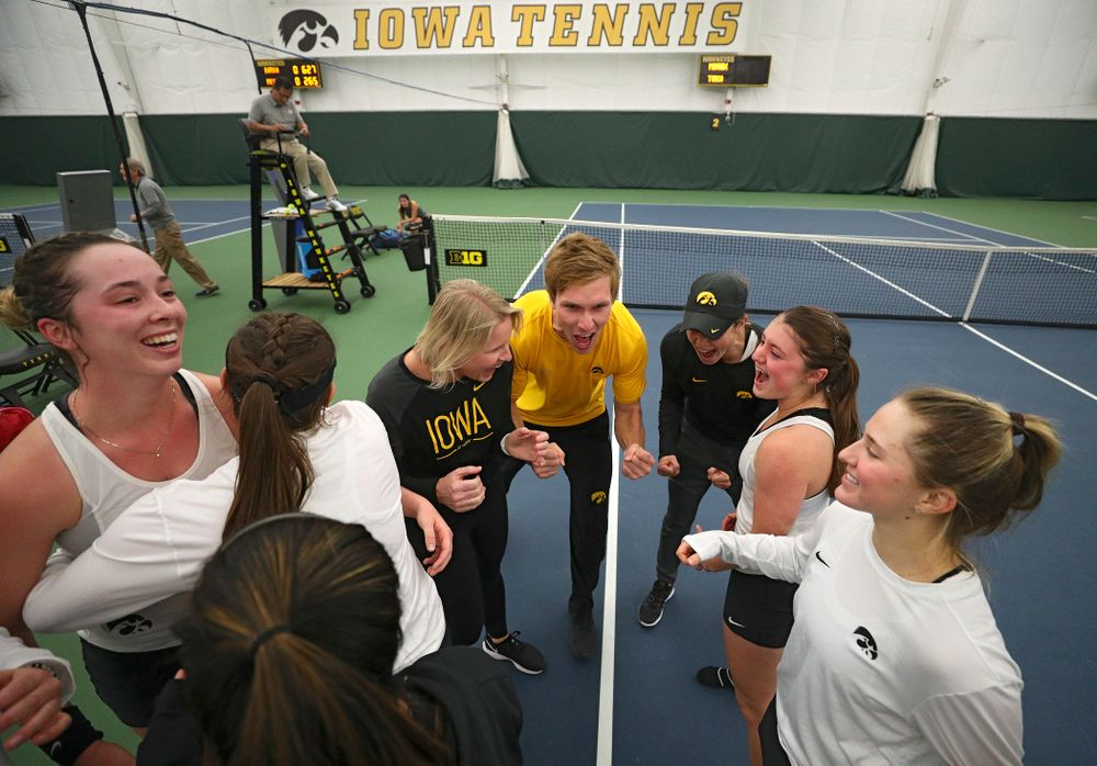 The Hawkeyes celebrate after winning their match at the Hawkeye Tennis and Recreation Complex in Iowa City on Sunday, February 23, 2020. (Stephen Mally/hawkeyesports.com)