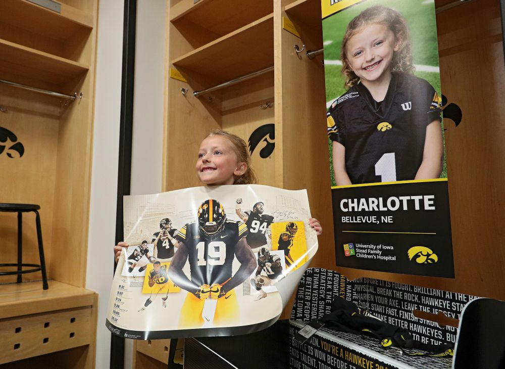 Kid Captain Charlotte Keller holds up a poster during Kids Day at Kinnick Stadium in Iowa City on Saturday, Aug 10, 2019. (Stephen Mally/hawkeyesports.com)