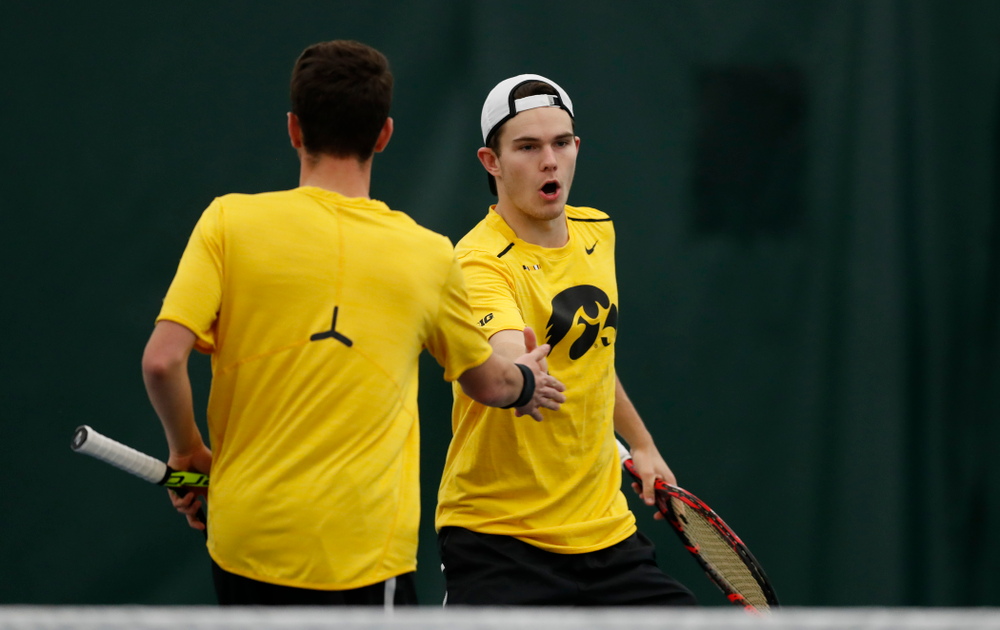 Jonas Larsen and Kareem Allaf play a doubles match against the Illinois Fighting Illini Saturday, March 31, 2018 at Hawkeye Tennis and Recreation Center. (Brian Ray/hawkeyesports.com)