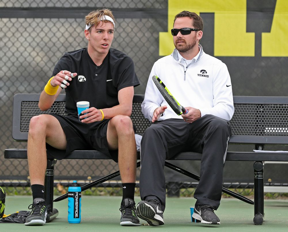 Iowa's Nikita Snezhko talks with head coach Ross Wilson during a match against Ohio State at the Hawkeye Tennis and Recreation Complex in Iowa City on Sunday, Apr. 7, 2019. (Stephen Mally/hawkeyesports.com)