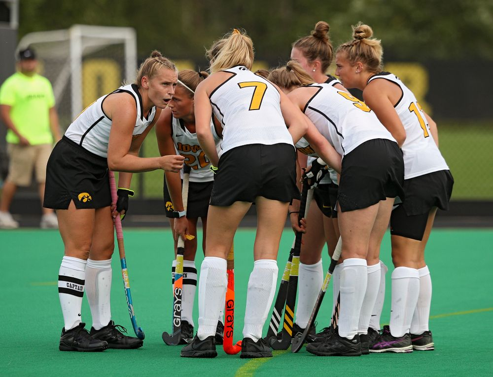 Iowa's Katie Birch (11) talks with her teammates before a penalty corner during the first quarter of their game at Grant Field in Iowa City on Friday, Sep 13, 2019. (Stephen Mally/hawkeyesports.com)