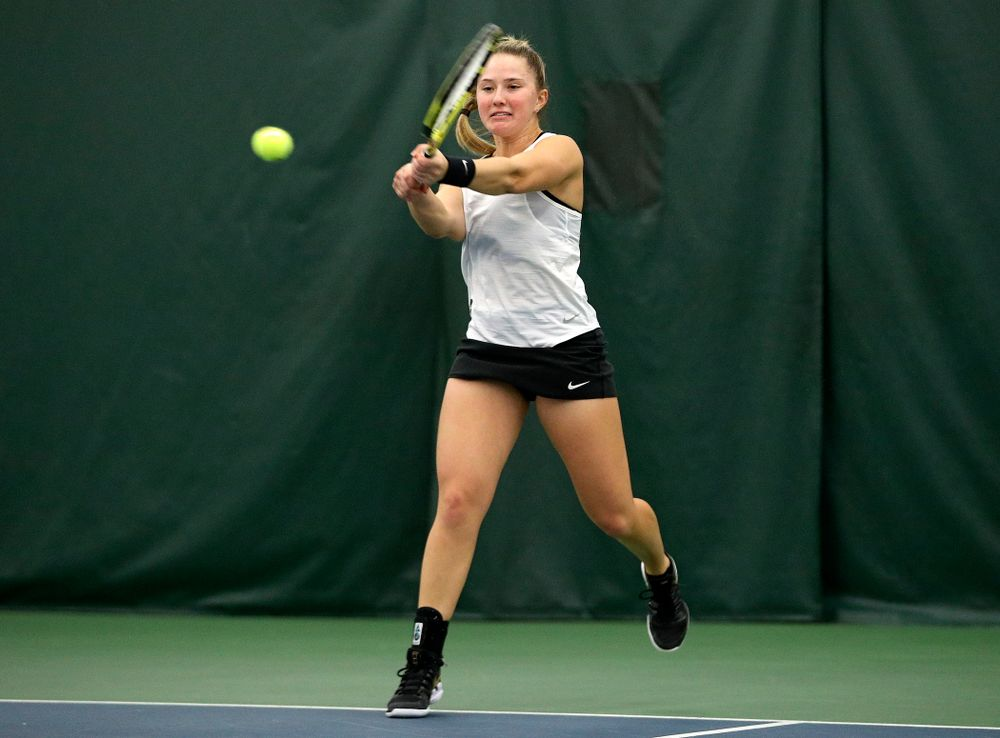 Iowa's Danielle Burich returns a shot during her doubles match at the Hawkeye Tennis and Recreation Complex in Iowa City on Sunday, February 23, 2020. (Stephen Mally/hawkeyesports.com)