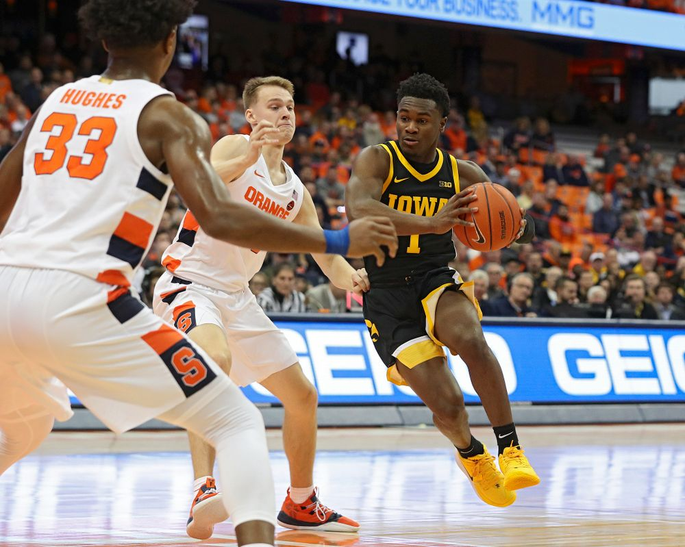 Iowa Hawkeyes guard Joe Toussaint (1) drives with the ball during the first half of their ACC/Big Ten Challenge game at the Carrier Dome in Syracuse, N.Y. on Tuesday, Dec 3, 2019. (Stephen Mally/hawkeyesports.com)