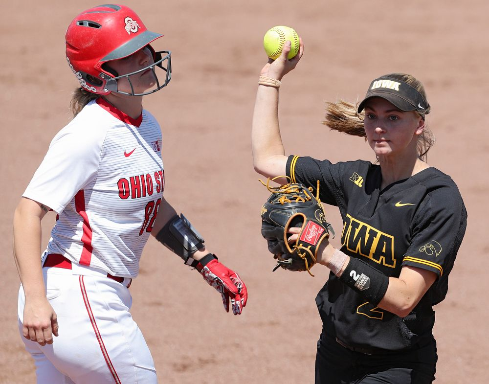 Iowa second baseman Aralee Bogar (2) throws to first base after tagging out a runner as she turns a double play during the second inning of their game against Ohio State at Pearl Field in Iowa City on Saturday, May. 4, 2019. (Stephen Mally/hawkeyesports.com)