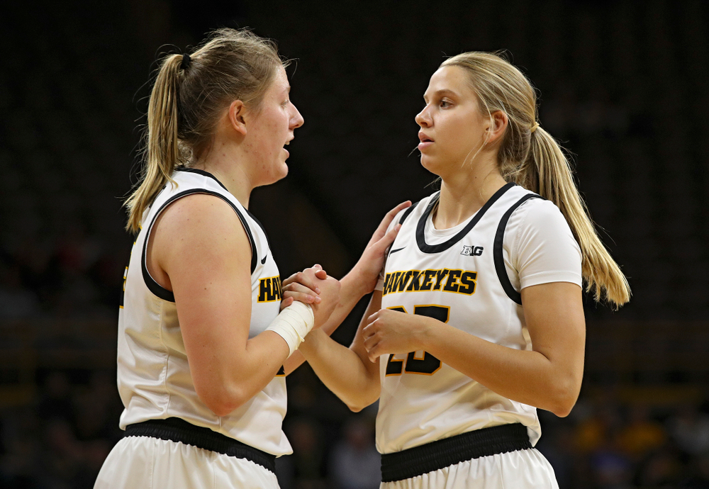 Iowa forward/center Monika Czinano (25) talks with forward Logan Cook (23) during the third quarter of their overtime win against Princeton at Carver-Hawkeye Arena in Iowa City on Wednesday, Nov 20, 2019. (Stephen Mally/hawkeyesports.com)