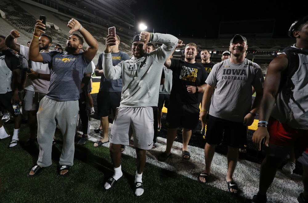 Members o the Iowa Football Team are not impressed by the new players first rendition of the ÒFight SongÓ  Thursday, August 22, 2019 at Kinnick Stadium in Iowa City. (Brian Ray/hawkeyesports.com)