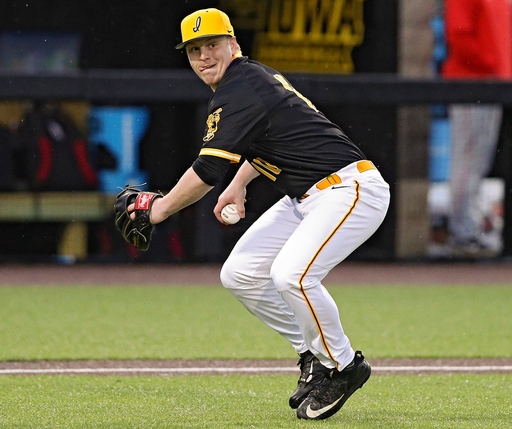 Iowa Hawkeyes pitcher Derek Lieurance (10) throws to first during the ninth inning of their game against Illinois State at Duane Banks Field in Iowa City on Wednesday, Apr. 3, 2019. (Stephen Mally/hawkeyesports.com)