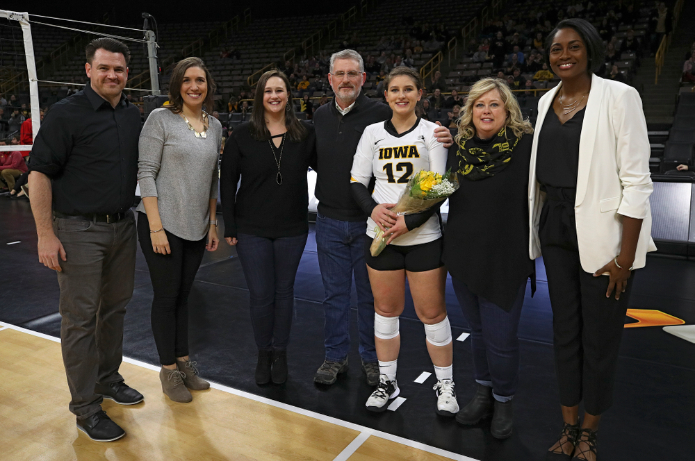 Iowa's Emily Bushman (12) is honored with her family and the coaching staff on Senior Day before their match at Carver-Hawkeye Arena in Iowa City on Saturday, Nov 30, 2019. (Stephen Mally/hawkeyesports.com)