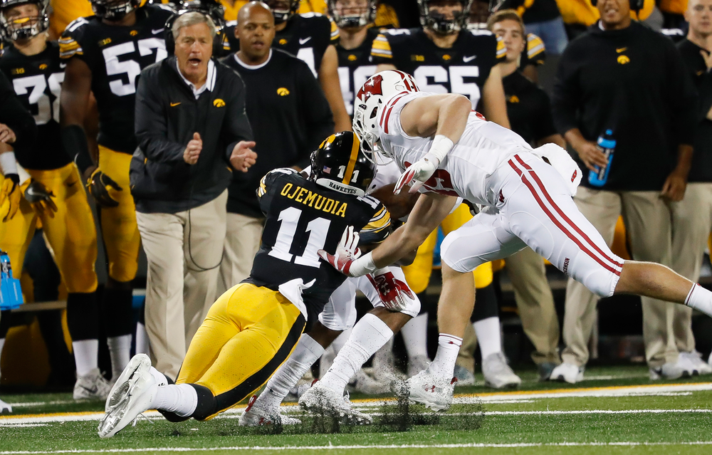 Iowa Hawkeyes defensive back Michael Ojemudia (11) makes a tackle during a game against Wisconsin at Kinnick Stadium on September 22, 2018. (Tork Mason/hawkeyesports.com)