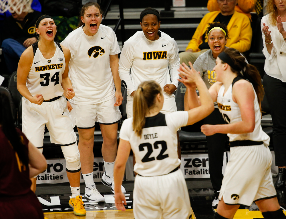 Iowa Hawkeyes forward Carly Mohns (34), Iowa Hawkeyes forward Paula Valino Ramos, Iowa Hawkeyes guard Zion Sanders (24)