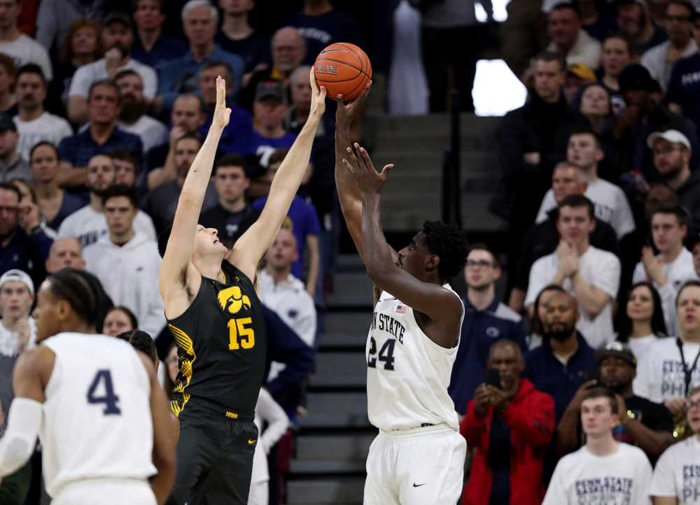 Iowa Hawkeyes forward Ryan Kriener (15) blocks a shot against Penn State Friday, January 3, 2020 at the Palestra in Philadelphia. (Brian Ray/hawkeyesports.com)