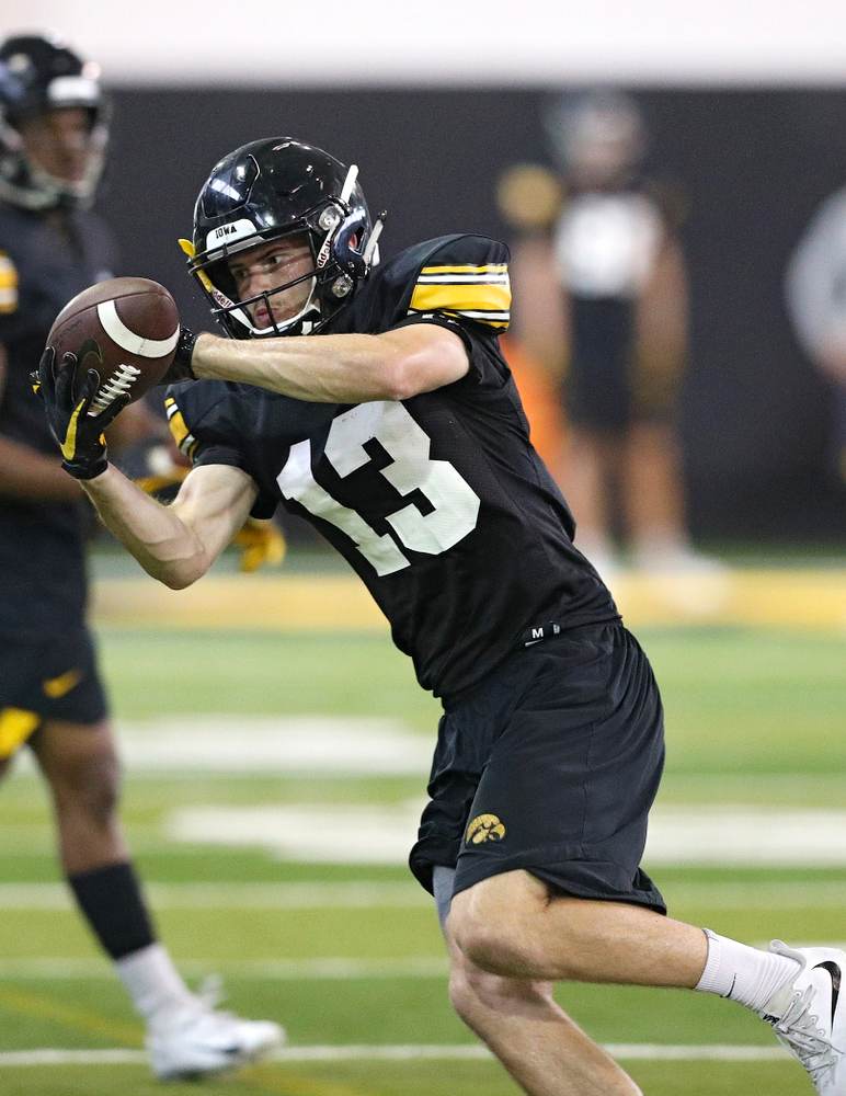 Iowa Hawkeyes wide receiver Henry Marchese (13) pulls in a pass during Fall Camp Practice No. 9 at the Hansen Football Performance Center in Iowa City on Monday, Aug 12, 2019. (Stephen Mally/hawkeyesports.com)