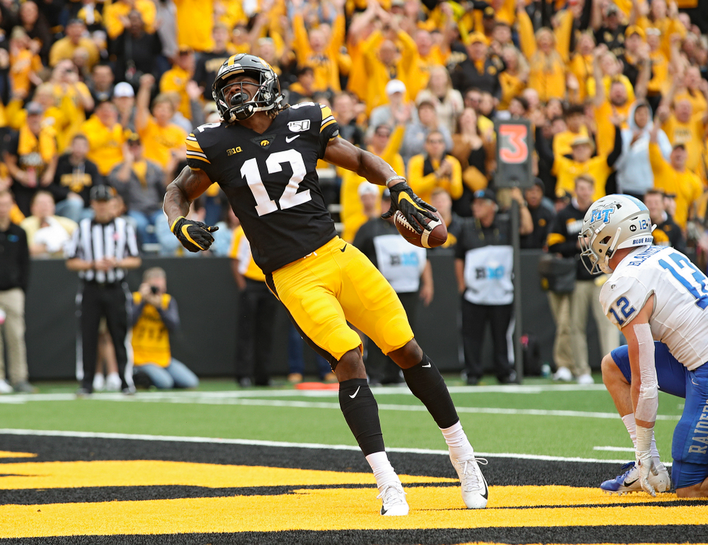 Iowa Hawkeyes wide receiver Brandon Smith (12) celebrates after a 10-yard touchdown reception during fourth quarter of their game at Kinnick Stadium in Iowa City on Saturday, Sep 28, 2019. (Stephen Mally/hawkeyesports.com)