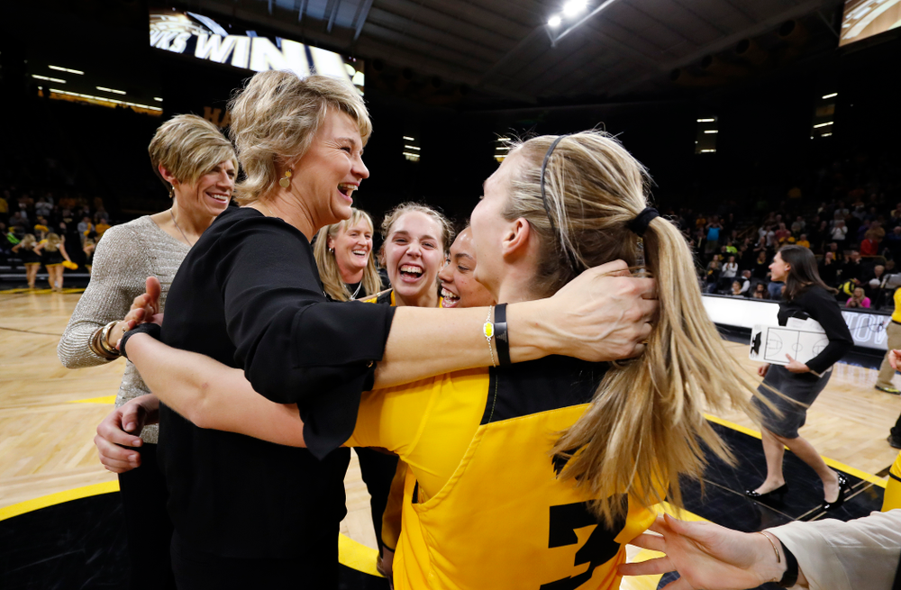 Iowa Hawkeyes head coach Lisa Bluder and guard Kathleen Doyle (22)