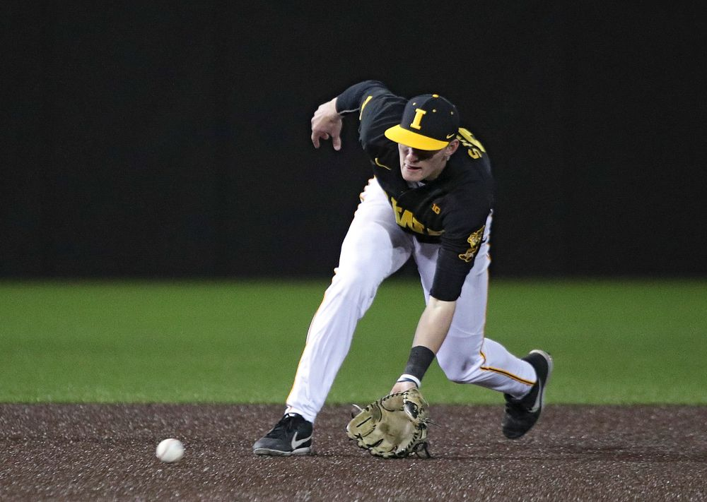 Iowa infielder Brendan Sher (2) fields a ground ball during the ninth inning of their game at Duane Banks Field in Iowa City on Tuesday, March 3, 2020. (Stephen Mally/hawkeyesports.com)