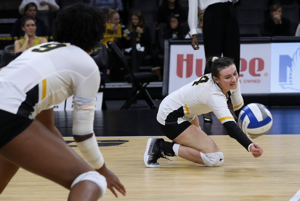 Iowa Hawkeyes defensive specialist Halle Johnston (4) dives for the ball during a match against Penn State at Carver-Hawkeye Arena on November 3, 2018. (Tork Mason/hawkeyesports.com)
