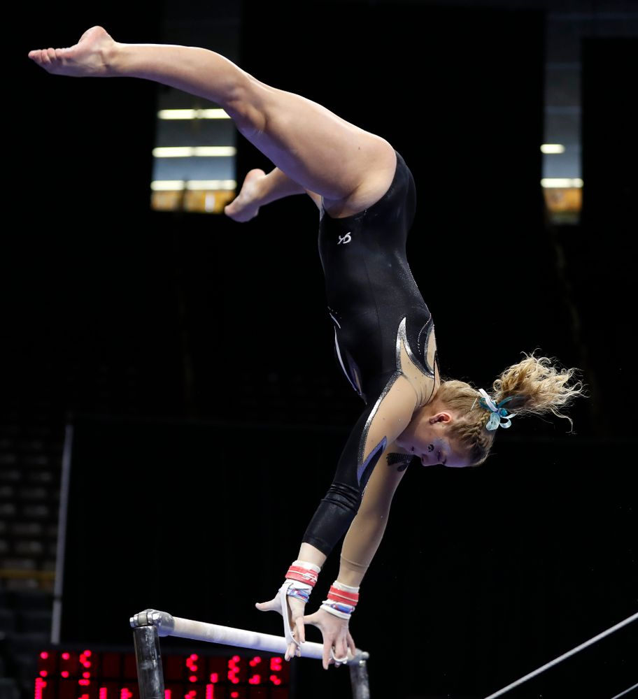 Iowa's Emma Hartzler competes on the bars against the Nebraska Cornhuskers