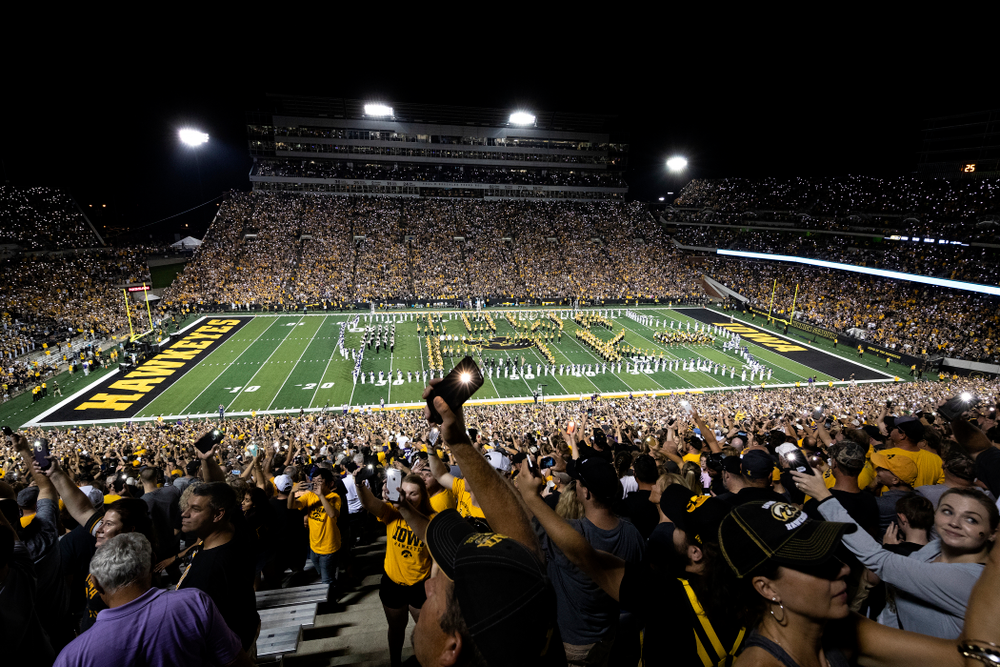 "Fans wave their cell phone lights as country artist Pat Green performs ""Wave on Wave"" during halftime of the Iowa Hawkeyes game against the Northern Iowa Panthers Saturday, September 15, 2018 at Kinnick Stadium. (Brian Ray/hawkeyesports.com)"